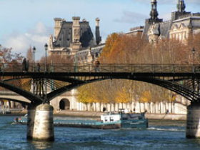 The Louvre can be admired on a Seine river cruise
